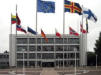 Åland Islands - The Parliament of Åland with the flags of (counterclockwise, starting with EU) European Union, Åland Islands, Finland, Sweden, Denmark, Norway, Poland, Germany, Estonia, Russia, Lithuania, and Latvia.