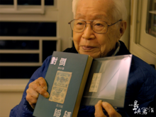 Liu holding a copy of his novel Intersection