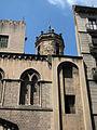 050 Sant Pere de les Puel·les, detall de façana i campanar.jpg