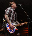 120302-N-KQ416-101 — lead vocalist and rhythm guitarist for the Grammy Award-nominated punk rock band Bowling for Soup, performs for Sailors (cropped).jpg