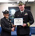 170427 - CAPT Fortson gives CMDCM Holliday honorable discharge certificate.jpg