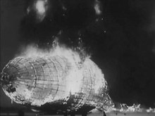 Datei:1937-05-10 Special Release - Zeppelin Explodes Scores Dead.ogv