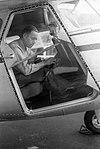 1949. Plexiglass main cabin door put on Cessna 195 for aerial forest insect damage detection surveys. J. Huber in observer's position. Portland, OR. (35303477841).jpg