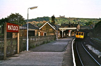 Matlock railway station - British Rail Class 104 BRCW dmu in 1975 with Riber Castle in background.