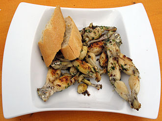Frog legs - French cuisses de grenouille served with slices of baguette