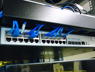 Network switch - A rack-mounted 24-port 3Com switch