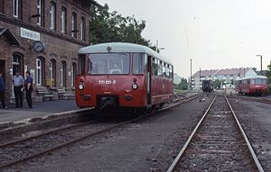 DR Class VT 2.09 -  771 015 (left) from the first series with curved windows, and unidentified vehicles from the later series (right) with straight windows in the corners of the cabs