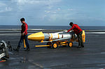 AIM-54C missile on trailer aboard USS Abraham Lincoln (CVN-72) 1990.JPEG