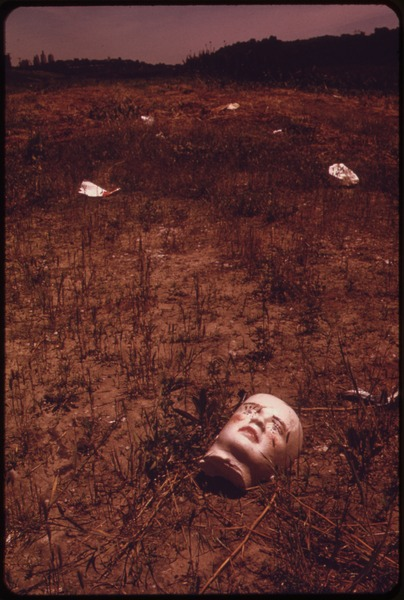 File:A BROKEN DOLL'S FACE BY THE RIVER EDGE-SILENT COMMENTARY ON MAN'S USE OF NATURE AS A JUNKYARD. NEAR THE 7TH STREET... - NARA - 552078.tif