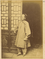 A Nanny or Servant from a Rich Household, in a Cotton Gown over Trousers, with Traditional Lotus (Bound) Feet. China, 1874 WDL1918.png