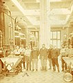 A group of workers in the main alambic hall at the Pernod Fils factory.jpg