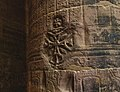A pillar in Philae temple with Hieroglyphics and Coptic carvings on top.jpg