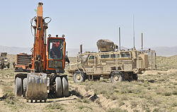 A route clearance vehicle with the 591st Engineer Company provides security for earthmoving equipment being used to construct a new Afghan Border Police checkpoint in the Spin Boldak district of Kandahar 130325-A-MX357-074.jpg