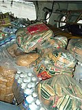 A still of relief materials for the flood-affected people in Gujarat on July 3, 2005.jpg