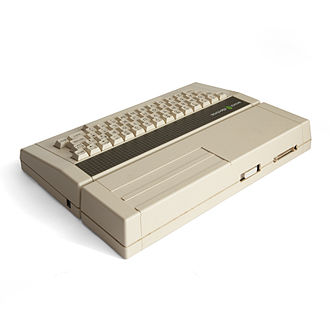Acorn Electron - An Acorn Electron with Plus 1 expansion unit attached