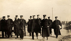 Yamamoto Gonnohyōe - Japanese Minister of the Navy, Admiral Baron Yamamoto visiting the captured city of Dalny, just north of Port Arthur in December 1904.  Accompanying the Minister were several Western observers, including Italian naval attaché Ernesto Burzagli who photographed the inspection tour.