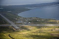 Aerial view of Cold Bay taken during the early 21st century. Cold Bay Airport's runways are visible.