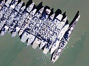 Aerial view of USS Iowa (BB-61) and other ships laid-up in Suisun Bay, California (USA), circa in the early 2000s