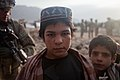 Afghan boys pose for a photo outside of Combat Outpost Senjaray, Kandahar province, Afghanistan, Jan. 3, 2012 120103-A-VB845-172.jpg