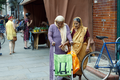 African Street Style Festival 2016 - Two elderly ladies passing by the festival site with a pushchair.png