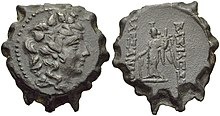 Coin of Alexander II. On the obverse, the bust of the god Dionysus surrounded by ivy leaves is shown. On the reverese the statue of a standing winged Tyche is depicted