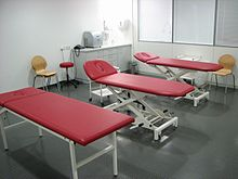 Massage room with three red massage tables