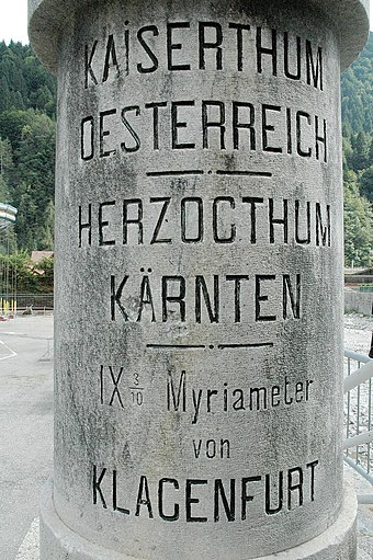 Stone marking the Austro-Hungarian/Italian border at Pontebba displaying myriametres (10 km), a unit used in Central Europe in the 19th century. Alter Grenzstein Pontebba 01.jpg