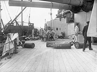 HMS Emperor of India - Loading shells aboard the ship during the war