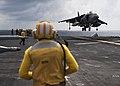 An AV-8B Harrier II lands on the flight deck of USS Boxer. (28252389134).jpg