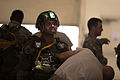 An Indian Army paratrooper gets his parachute inspected by a U.S. Army jumpmaster prior to an airborne operation in 2013.jpg