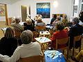 Angela Hennessy Atelierfest 2012, 25b, der irische Golflehrer und Gitarrist Jim Patterson mit Mundharmonika im Großen Saal des Ateliers.JPG