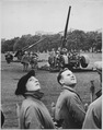 """Anti-aircraft guns in Hyde Park go into action as """"enemy bombers"""" make a daylight raid on London, during giant air... - NARA - 541897.tif"""