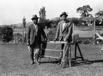 Āpirana Ngata - Ngata and Te Rangi Hīroa alongside a tukutuku panel at Ngata's home, during an expedition by Elsdon Best, James Ingram McDonald and Johannes Andersen.