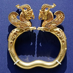 Oxus Treasure - One of a pair of armlets from the Oxus Treasure, which has lost its inlays of precious stones or enamel