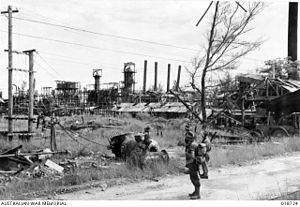 Australian troops look at the damaged oil refinery installations, near Miri.