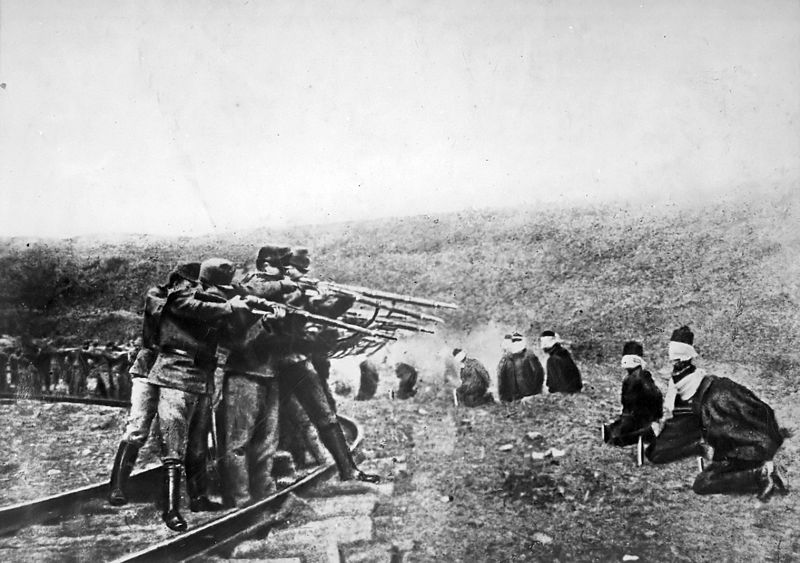 Wikipedia photo and caption: Austro-Hungarian troops executing captured Serbians, 1917. Serbia lost about 850,000 people during the war, a quarter of its pre-war population.