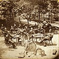 Band members seated at tables at Schnaider's Garden. Chouteau Avenue between Mississippi and Armstrong.jpg