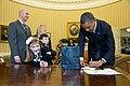 Barack Obama signs memorabilia in the Oval Office for an overjoyed Nina Centofanti, 8, 2015.jpg