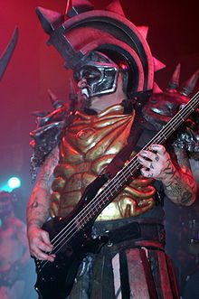 Oderus Urungus was played by Dave Brockie and has been the longeststanding character in GWARs historyhe and Dave have been with the band since its genesis He originally started on guitar then moved to bass then finally stayed on vocals His guitar skills were reportedly poor