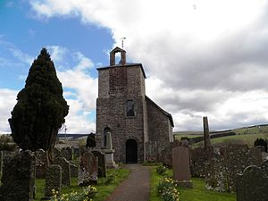 Bewcastle - Image: Bewcastle church and cross from the west