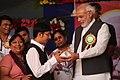 Binish Receiving honor by PM Narendra Modi.jpg