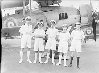 Last battle of the battleship Bismarck - Five aircrew from HMS Ark Royal who were decorated for their part in the Bismarck attack, photographed in front of a Swordfish bomber