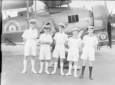 Five aircrew from HMS Ark Royal who were decorated for their part in the Bismarck attack, photographed in front of a Swordfish bomber Bismarck aircrew rewarded.jpg