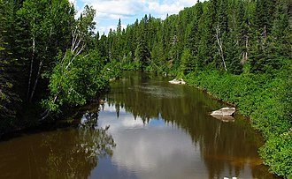 Blanche River (Lake Timiskaming) - Blanche River, looking north from Pacaud Chamberlain Boundary Road in Krugerdorf, Ontario