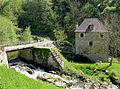 Boussac (Creuse) - Site avec la rivière Beroux, le moulin et le pont.JPG