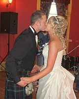 Bride and groom kiss after their first dance.jpg