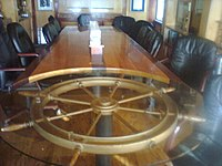 Britannia Yacht Clubu0027s Commodore Boardroom Features A Shipu0027s Wheel Table