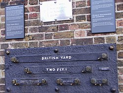 Etalons on the wall of Royal Observatory Greenwich, London, Great Britain depicting length measures - 1 yard (3 feet), 2 feet, 1 foot, 6 inches (1/2 foot), and 1 inch.