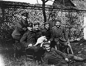 "Military career of Adolf Hitler - Hitler sitting at far right among soldiers of the ""List"" regiment and Fuchsl."