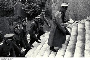 Paul Hausser - Paul Hausser (far right, in overcoat) walking up the Stairs of Death at the Mauthausen-Gusen concentration camp, June 1941.